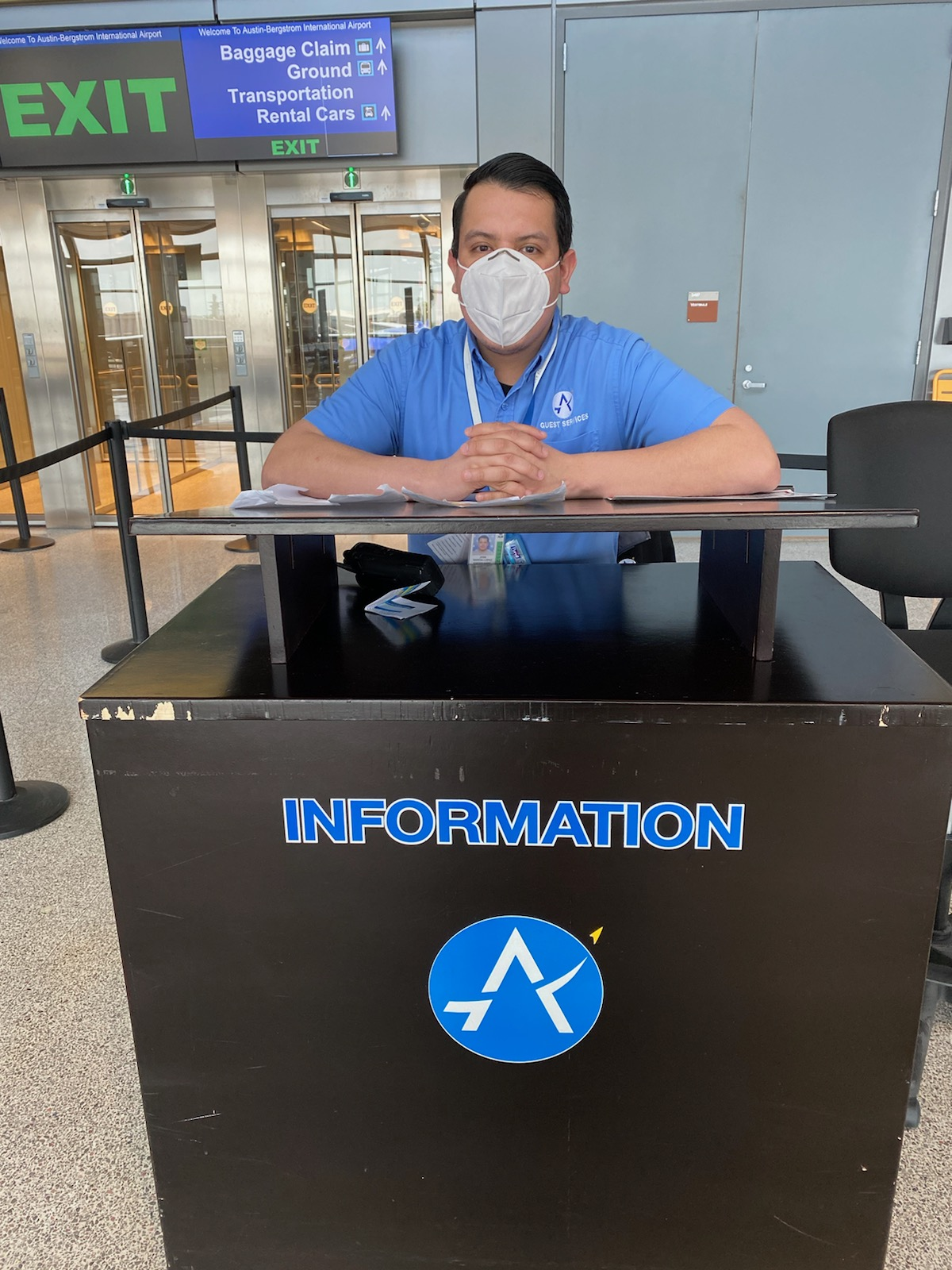 AUS Guest Services representative wears a mask while in the terminal