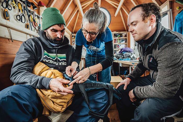 Patagonia team members repair clothing