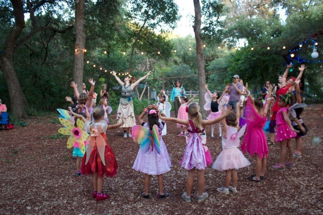 The Faerie Dance Troop instructing visitors at the 2016 Woodland Faerie Trail by Moonlight