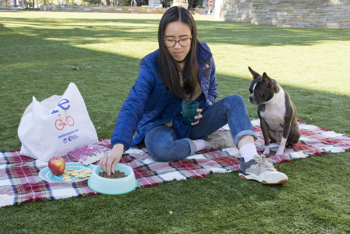 Woman has a picnic with her Boston Terrier, using her reusable bag
