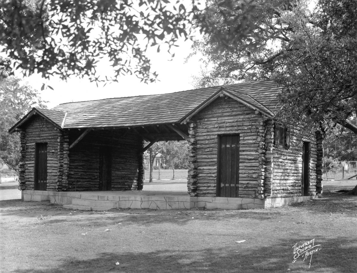 A black and white photo of the Shipe Park log cabin shelter house.