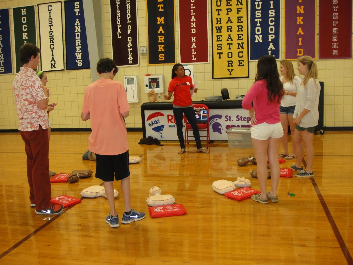 A student from St. Stephen's Episcopal School in Austin leading a TAKE10 Compression Only CPR class in the school gym