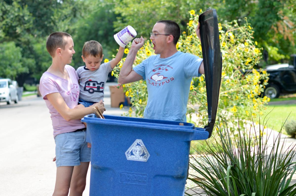 Image of family recycling outside.