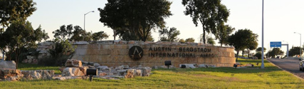 entrance sign to Austin Bergstrom International Airport
