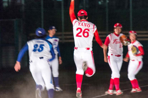 A baseball player jumps in the air