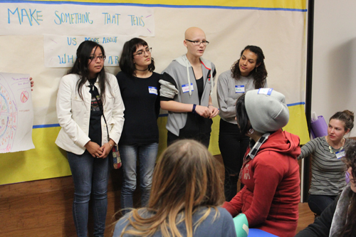 Four students making a presentation to a classroom