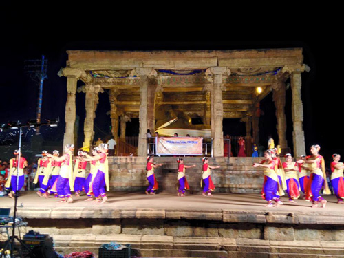 Dancers perform in front of a temple