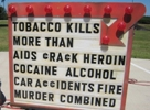 Sign that says tobacco kills more than many other causes combined.