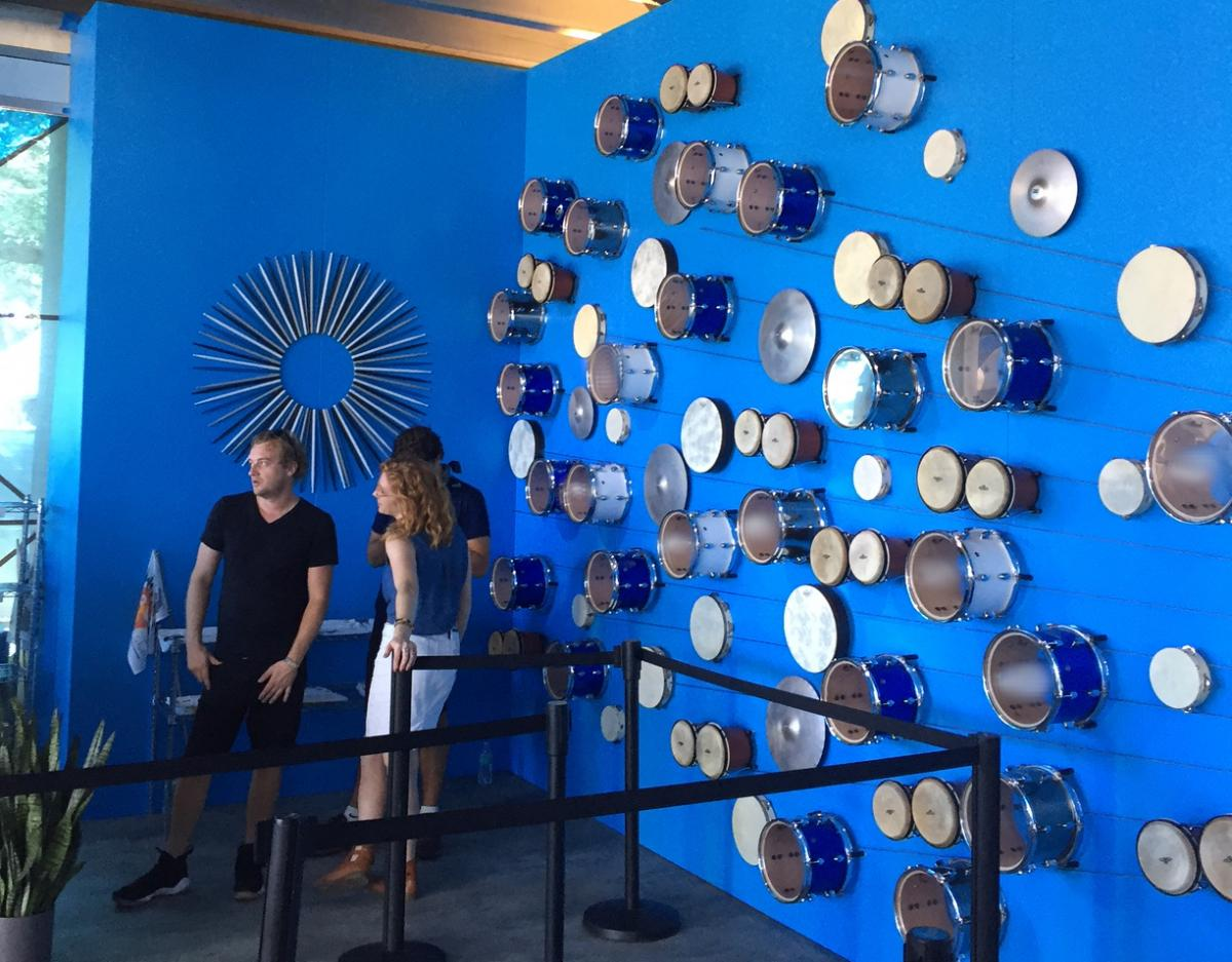 Drums and drumsticks decorate a wall in the 'American Express Experience' VIP tent at ACL.