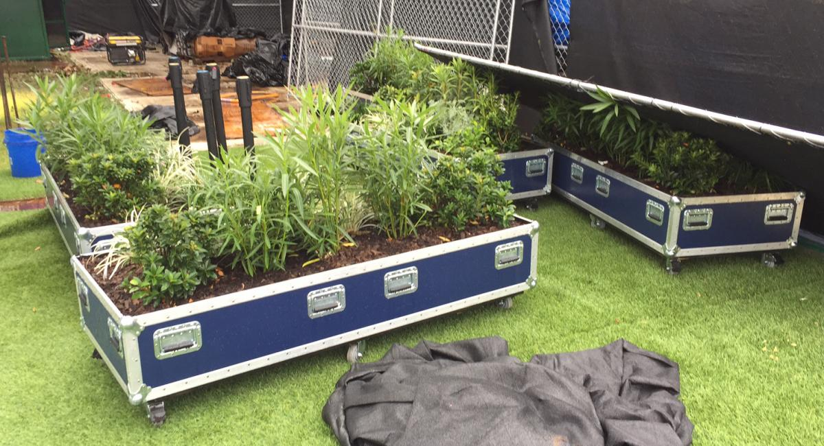 decorative planters from ACL stage structures being loaded up and sent to community partners for reuse.