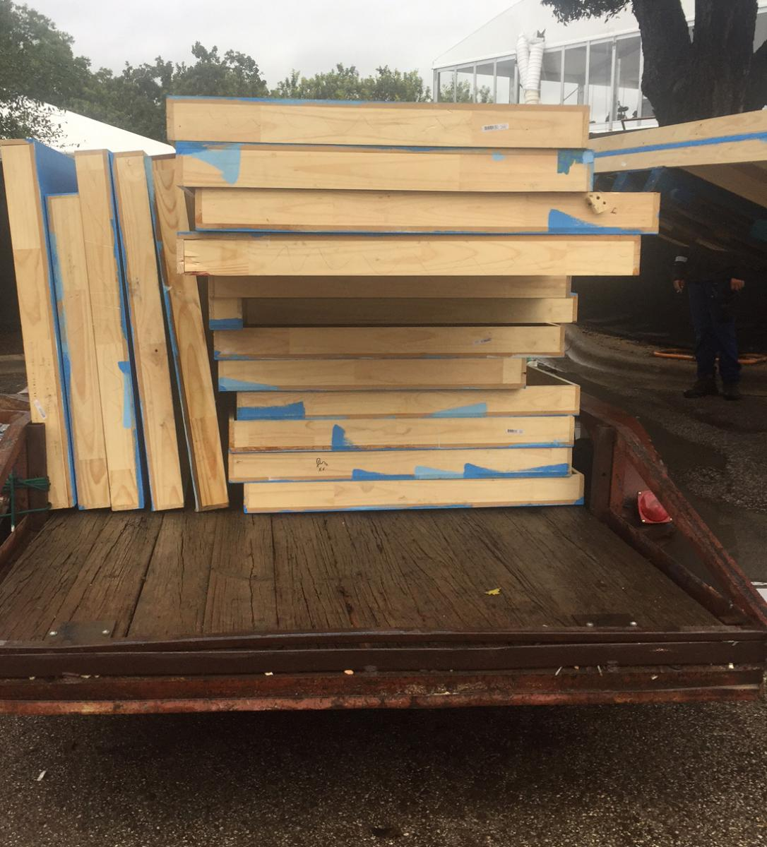 plywood from ACL stage structures being loaded up and sent to community partners for reuse.