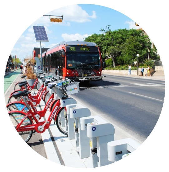 Picture of bus next to bikes to illustrate multi-modal