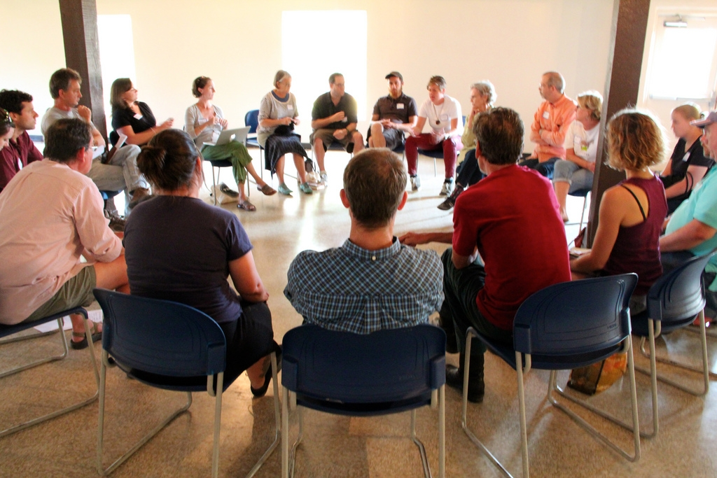 Participants in a discussion circle at an Urban Farm Code Update public meeting