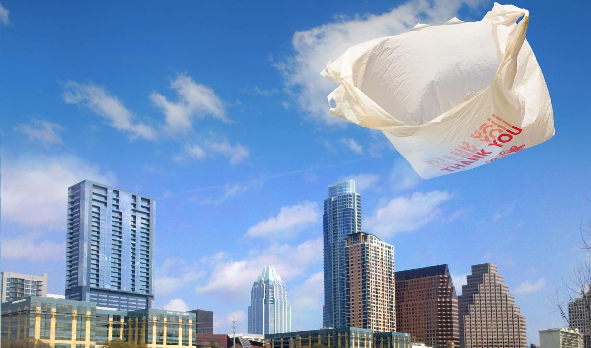 Plastic bag blowing in wind with Austin skyline
