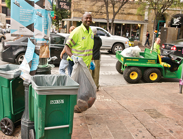ARR employees in front of trash carts