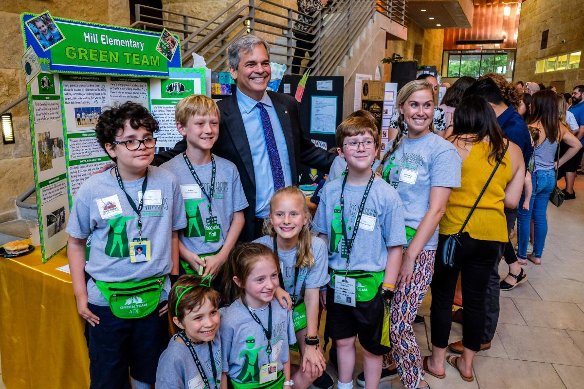 Mayor Steve Adler posing with students at the Student Innovation Showcase