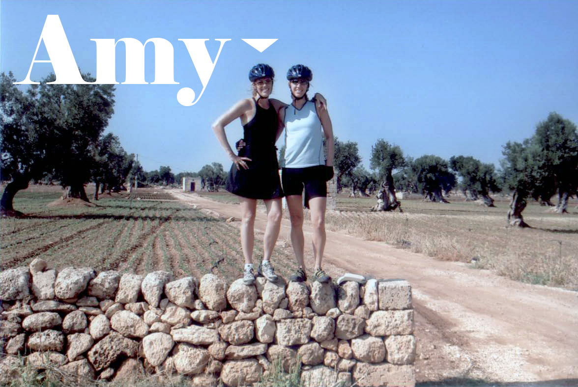 Text: Amy over picture of Amy and her sister in Italy wearing bike helmets