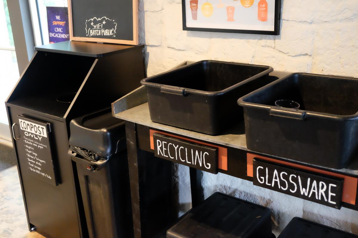 Compost, recycling, and glass bins.