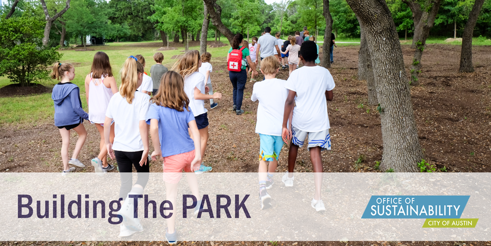"Photo of lots of school-age kids walking on a trail. Photo is shot from behind. The text overlay reads ""Building The PARK"". There is an Office of Sustainability logo in the lower right hand corner."