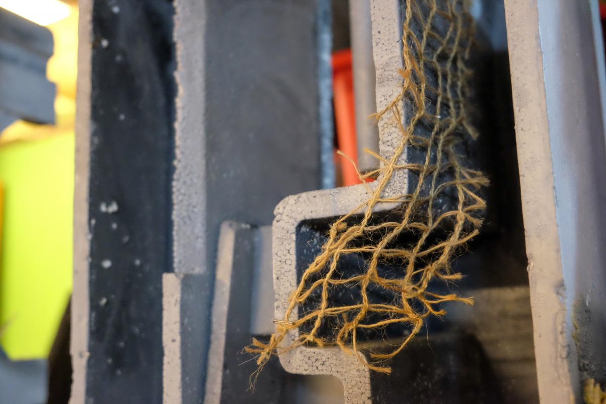 Tiny ladder made of twine.