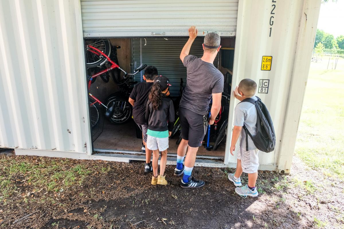 Getting bicycles out of the bicycle shed.
