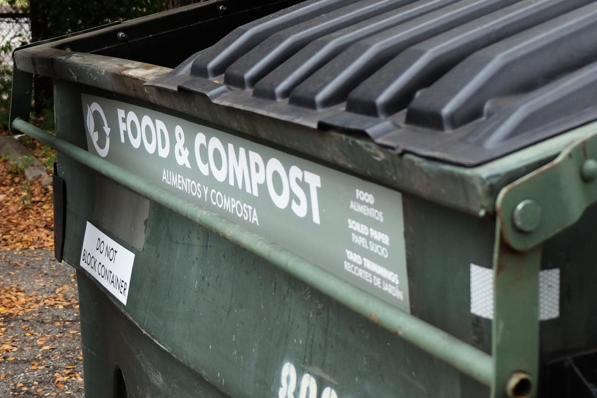 "Large compost dumpster labeled ""Food & Compost"""