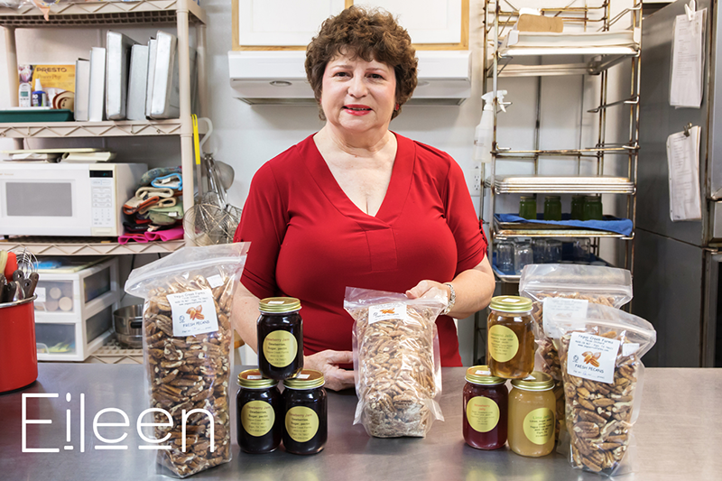 Eileen in her commercial kitchen with bagged pecans in the foreground.