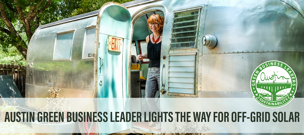 Photo: person looking out of an airstream. She is smiling and has bright red-orange hair. Text reads: Austin Green Business Leader lights the way for off-grid solar