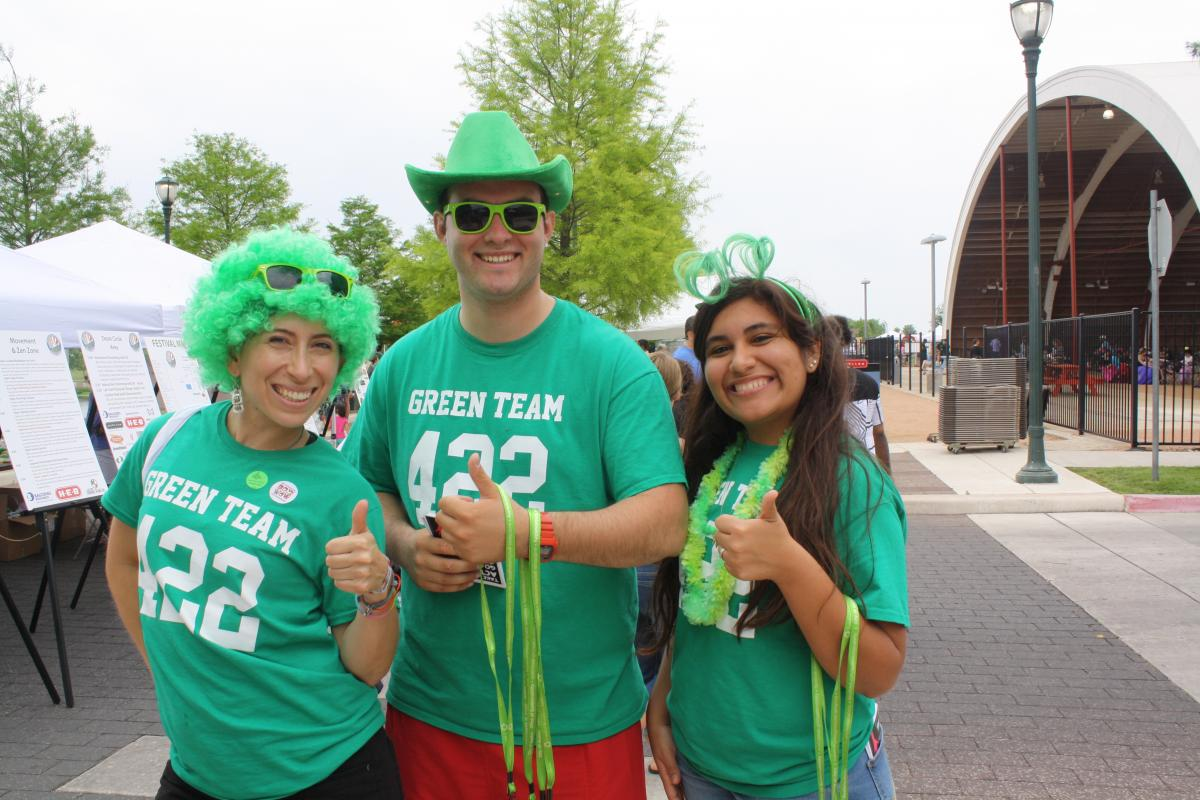 image of three people wearing green