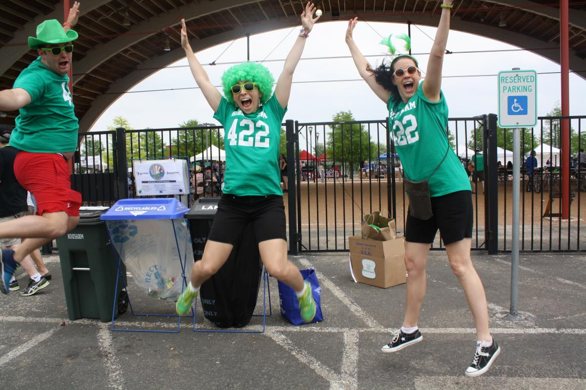 image of members of the green team jumping for the camera