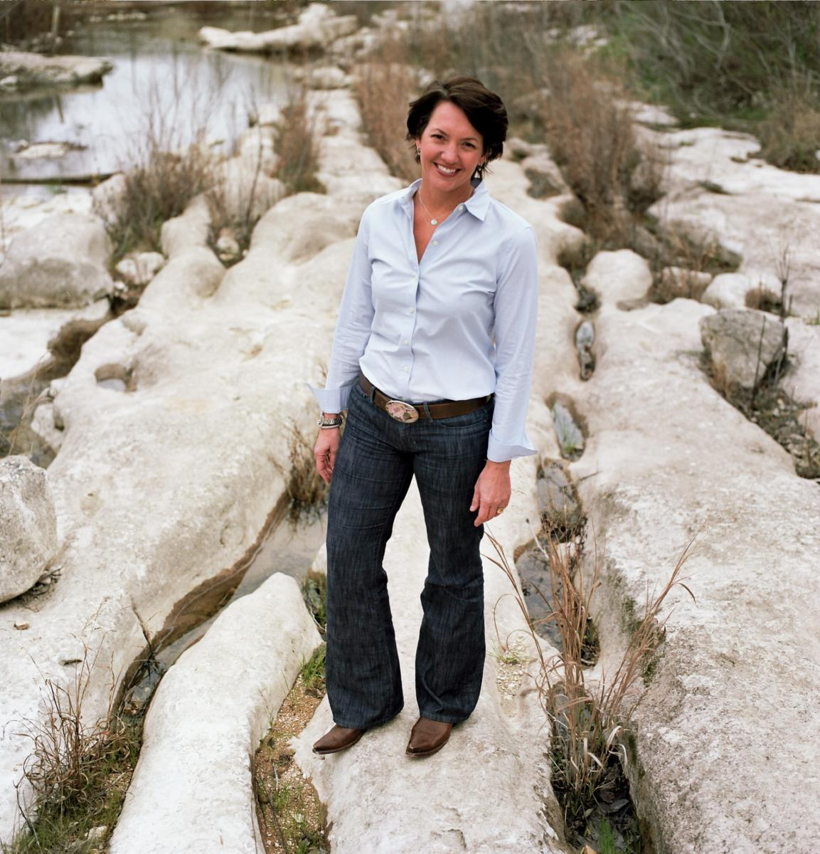 Laura Huffman standing in a creek bed.