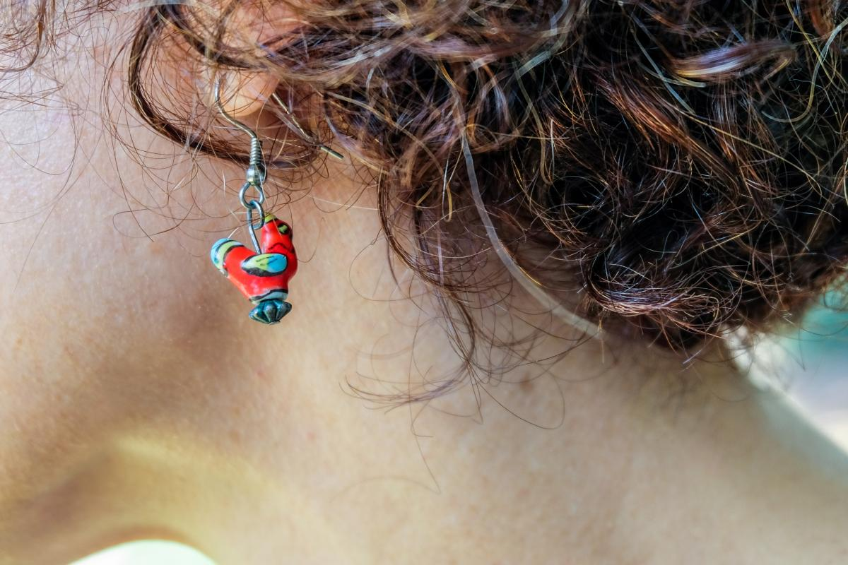Close-up of Michelle's chicken earring