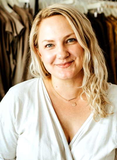 Headshot of Miranda Bennett. She has blonde hair and is wearing a white top.