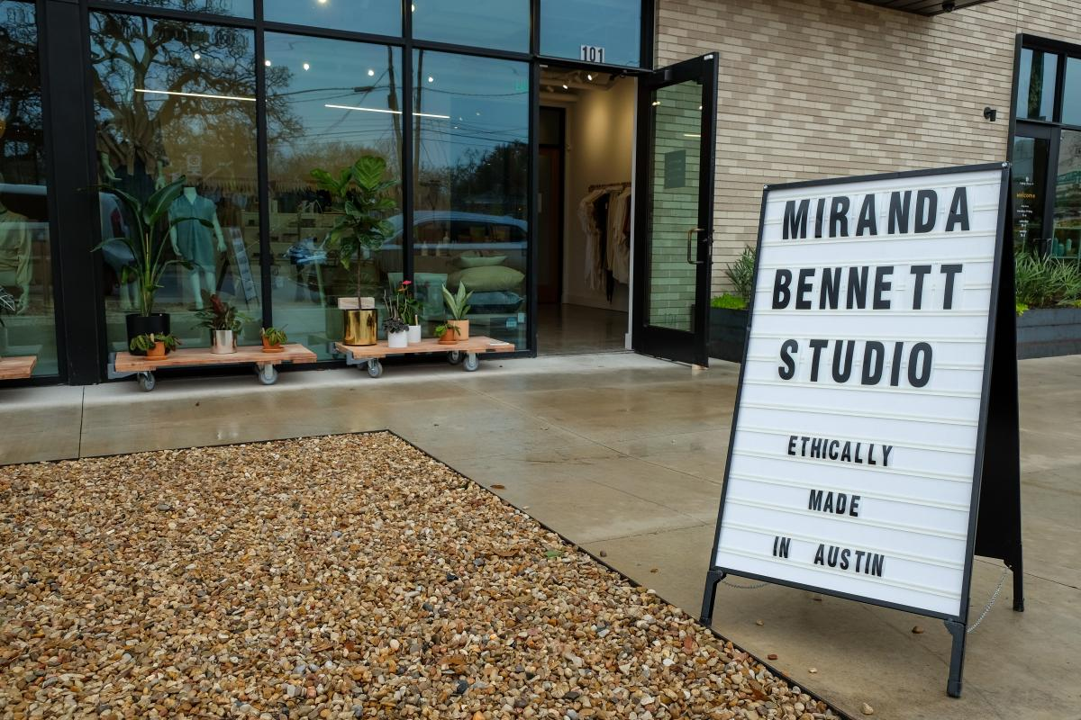 "Exterior of Miranda Bennett Studio. Sign reads ""Miranda Bennett Studio - Ethically made in Austin, Texas"""