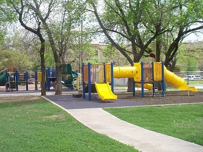 Playscape with bright yellow slides.