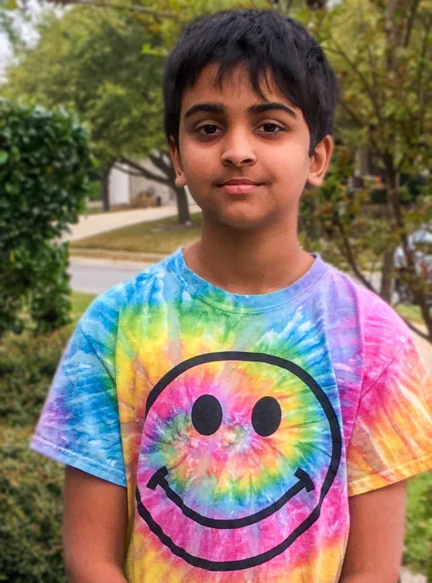 Headshot of Pranav Sarma. He is wearing a tie-dye shirt with a happy face on it.