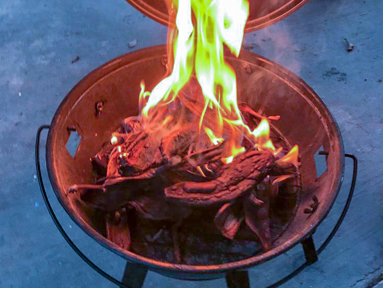 Waste material in a fire pit on fire.