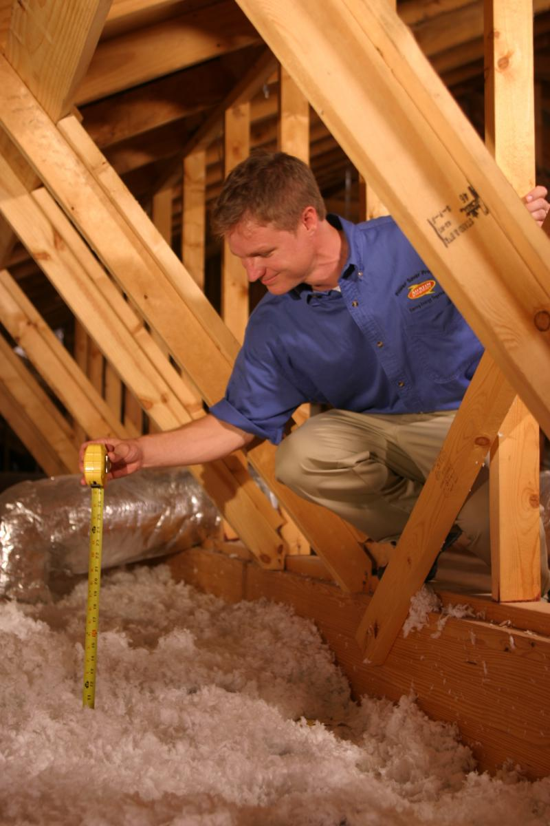 image of attic insulation installation in a home