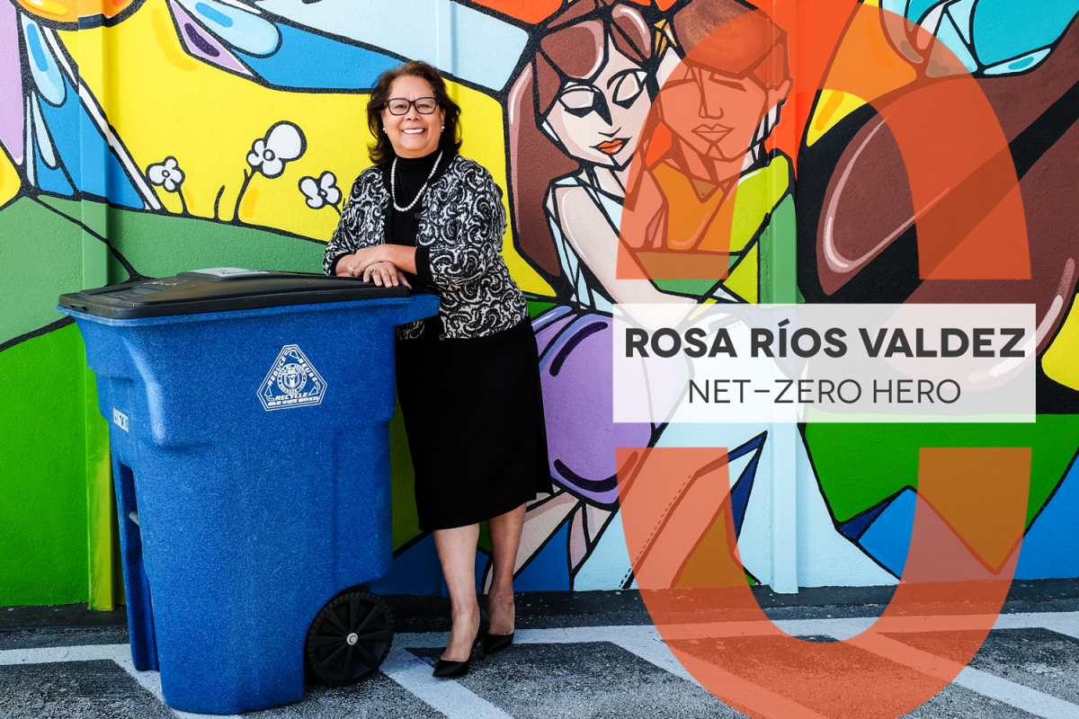 Net-Zero Hero Rosa Ríos Valdez, Rosa is pictured leaning on a recycling bin with a colorful mural behind her.