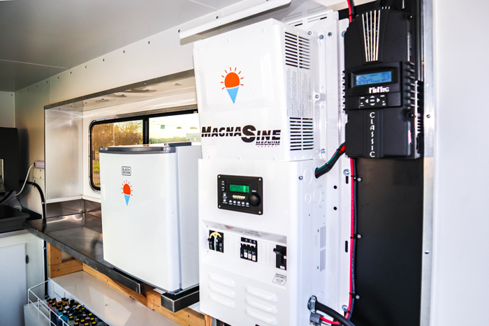 Solar inverters and equipment inside trailer.
