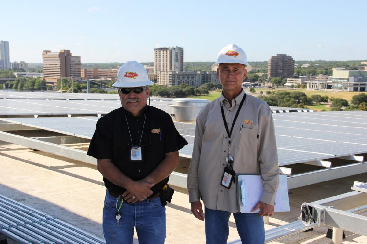 Austin Enery solar inspectors on the new Central Library roof.