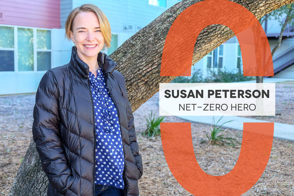 Photo of Susan Peterson in a black jacket and blue and white polka dot top. Text reads: Susan Peterson Net-Zero Hero