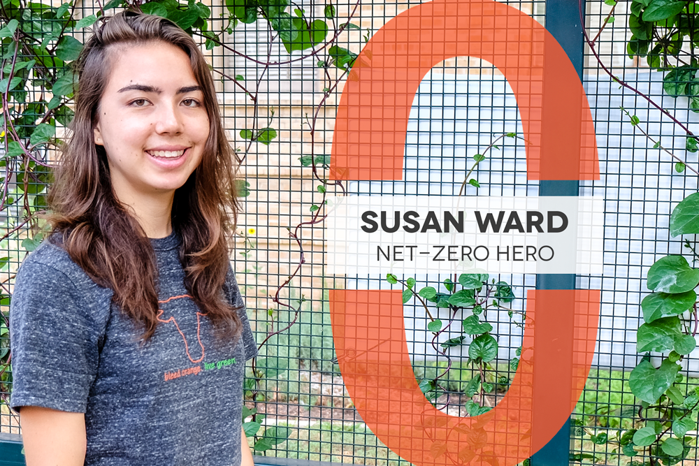 Text: Net-Zero Hero Susan Ward, Photo of Susan standing in front of gate with spinach vines growing behind her.