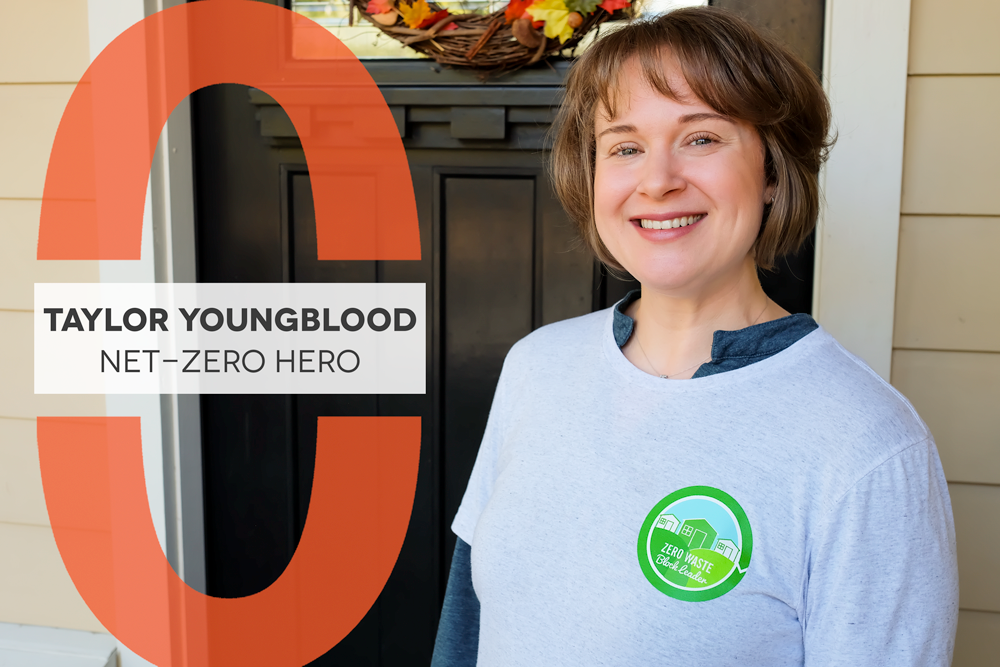 "Photo of woman with short brown hair in front of a doorway to a home. Text reads ""Taylor Youngblood Net-Zero Hero"""