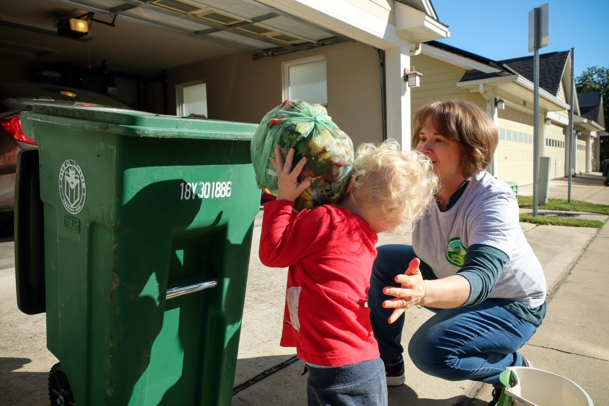Taylor and her son composting
