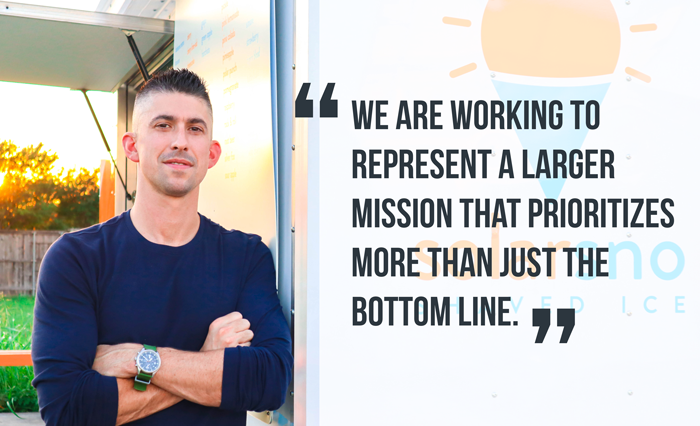"Tom with arms crossed next to solar trailer. Quote reads ""We are working to represent a larger mission that prioritizes more than just the bottom line."""