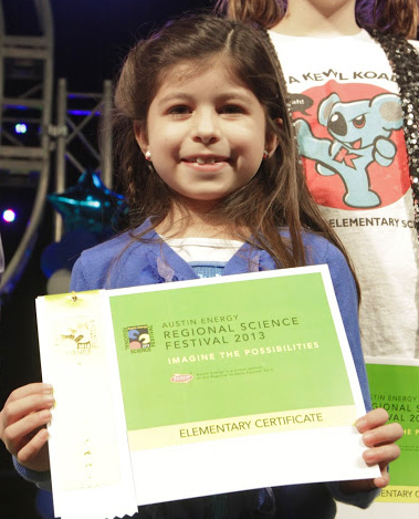 Young Girl Holding Certificate