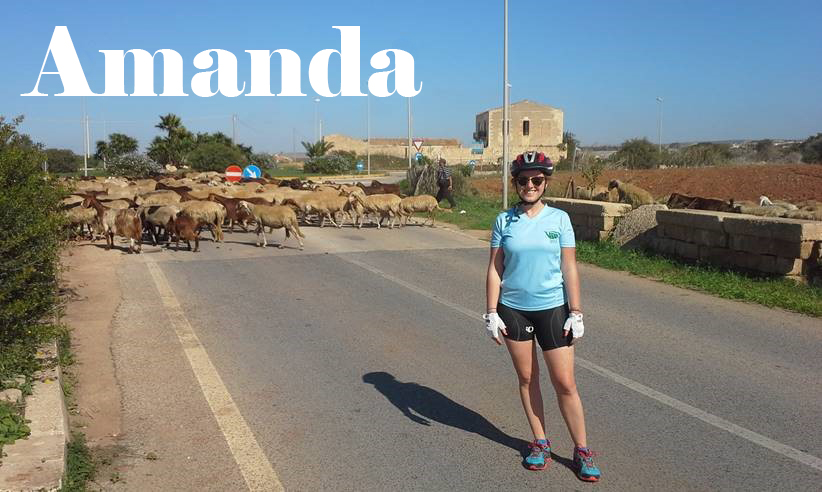 Text: Amanda, picture of Amanda with sheep in background