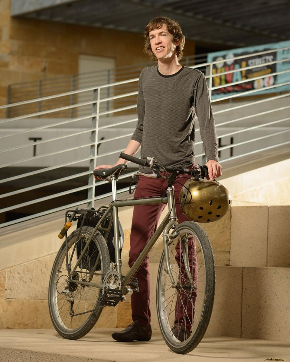 image of city worker with bike at city hall