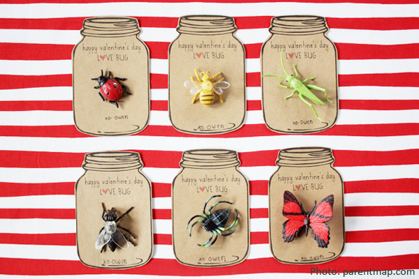 Six home-made cards in the shape of mason jars with bugs on them. Background is white and red striped.